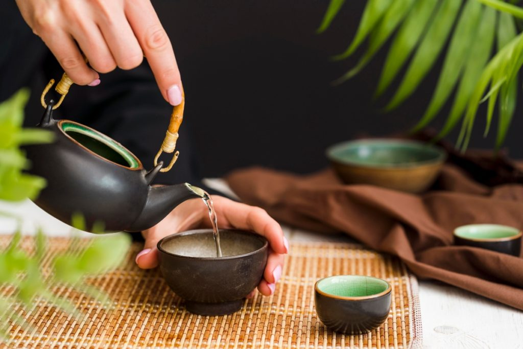 delmarte-high-quality-tea-woman-pouring-tea-cup-with-teapot