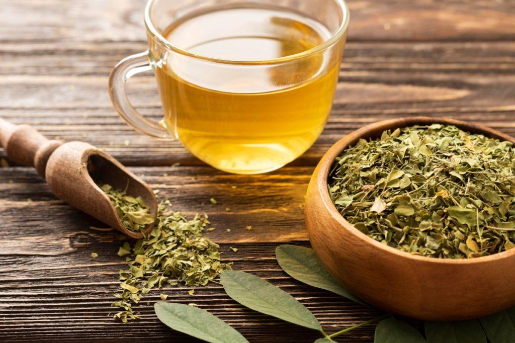delmarte-high-quality-tea-high-view-green-leaves-cup-tea
